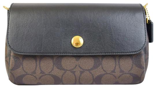 Preload https://item2.tradesy.com/images/coach-ruby-revesible-in-signature-59534-brown-coated-canvas-cross-body-bag-23336146-0-1.jpg?width=440&height=440