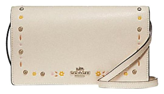 Preload https://item4.tradesy.com/images/coach-foldover-clutch-in-floral-tooling-f-26007-chalk-leather-cross-body-bag-23336188-0-1.jpg?width=440&height=440