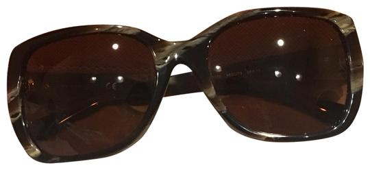 Preload https://item3.tradesy.com/images/tory-burch-brown-ty7086-sunglasses-23336367-0-2.jpg?width=440&height=440