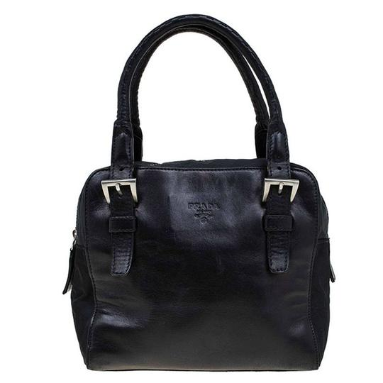 Preload https://img-static.tradesy.com/item/23336379/prada-leather-and-vintage-black-nylon-satchel-0-0-540-540.jpg