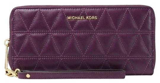 Preload https://item1.tradesy.com/images/michael-kors-jet-set-travel-quilted-leather-continental-walle-damson-leather-wristlet-23336840-0-1.jpg?width=440&height=440