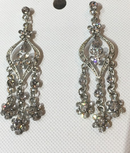 Preload https://img-static.tradesy.com/item/23336943/clear-dangling-rhinestone-pierced-earrings-0-0-540-540.jpg