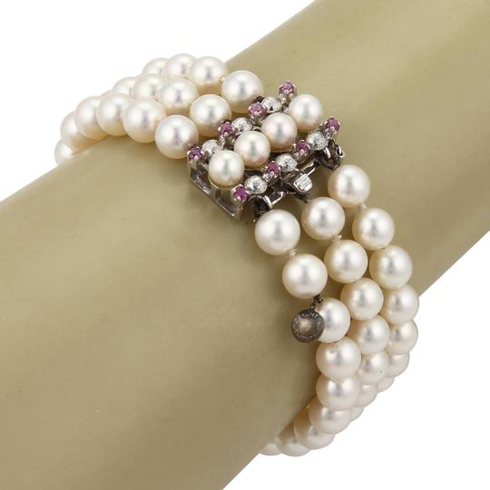 Preload https://item5.tradesy.com/images/19428-pearls-and-pink-sapphire-18k-gold-triple-strand-bracelet-23337199-0-1.jpg?width=440&height=440