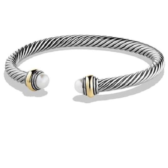 David Yurman David Yurman Never Worn Pearl 14k and Sterling Silver Cable Bangle 14k Yellow Gold and Sterling Silver Beautiful pearl at both ends of the bracelet 5mm Medium 100% Authentic Guaranteed Comes inside original David Yurman pouch!
