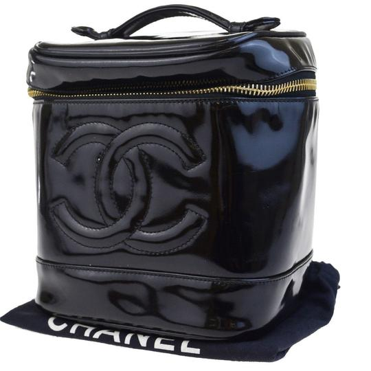 Preload https://item5.tradesy.com/images/chanel-black-cc-logos-vanity-hand-patent-leather-france-cosmetic-bag-23337769-0-0.jpg?width=440&height=440