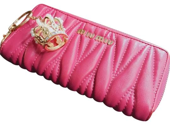 Preload https://item3.tradesy.com/images/miu-miu-hot-pink-leather-long-made-in-italy-wallet-23337952-0-2.jpg?width=440&height=440