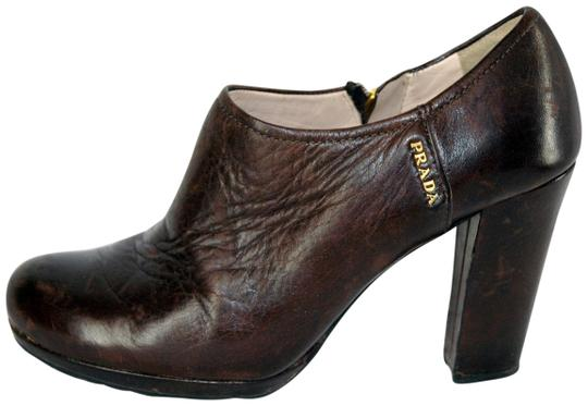 Preload https://item3.tradesy.com/images/prada-brown-leather-ankle-bootsbooties-size-eu-365-approx-us-65-regular-m-b-23338397-0-1.jpg?width=440&height=440
