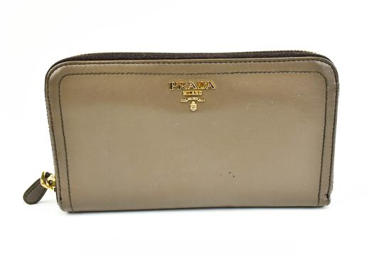 Preload https://item3.tradesy.com/images/prada-brown-leather-and-logo-long-ziparound-wallet-23338417-0-0.jpg?width=440&height=440