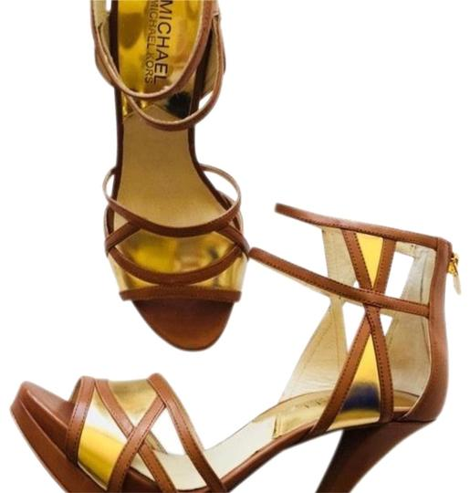 Preload https://img-static.tradesy.com/item/23338579/michael-michael-kors-brown-and-gold-strappy-cut-out-platforms-size-us-7-regular-m-b-0-3-540-540.jpg