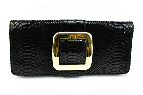 Preload https://item3.tradesy.com/images/michael-kors-black-leather-python-evening-bag-clutch-23338662-0-0.jpg?width=440&height=440