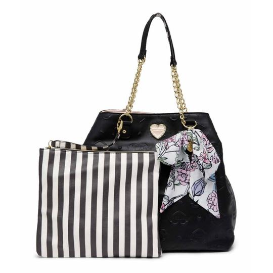 Preload https://item1.tradesy.com/images/betsey-johnson-quilted-trap-black-faux-leather-tote-23339075-0-0.jpg?width=440&height=440
