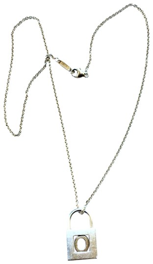 Preload https://item4.tradesy.com/images/tiffany-and-co-silver-alphabet-lock-pendent-necklace-23339098-0-1.jpg?width=440&height=440