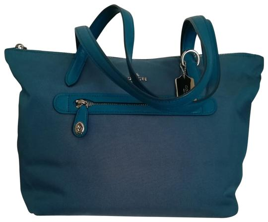 Preload https://item3.tradesy.com/images/coach-35500-tealpeacock-blue-teal-nylon-tote-23339102-0-1.jpg?width=440&height=440