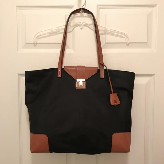 Preload https://img-static.tradesy.com/item/23339182/tory-burch-penn-flap-lock-leather-black-brown-nylon-tote-0-0-540-540.jpg