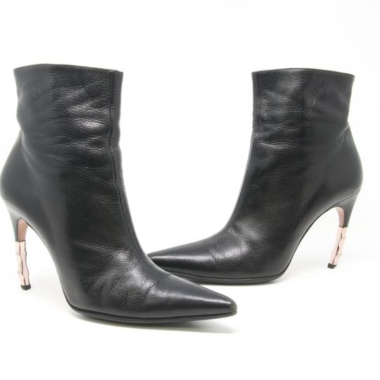 Preload https://item5.tradesy.com/images/gucci-black-classic-goatskin-leather-pointed-toe-ankle-bootsbooties-size-us-85-regular-m-b-23339299-0-0.jpg?width=440&height=440