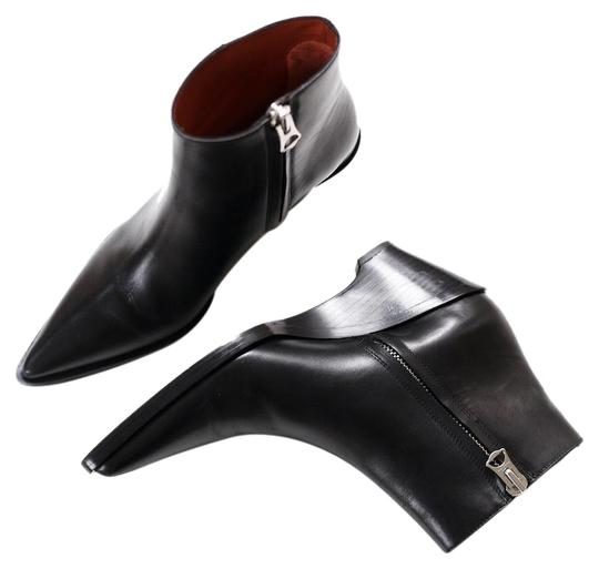 Preload https://img-static.tradesy.com/item/23339367/acne-studios-black-cony-leather-ankle-bootsbooties-size-eu-37-approx-us-7-regular-m-b-0-1-540-540.jpg