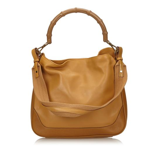 Preload https://item2.tradesy.com/images/gucci-bamboo-handbag-brown-leather-x-others-x-natural-material-x-others-baguette-23339391-0-0.jpg?width=440&height=440