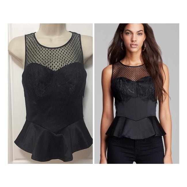 Preload https://item2.tradesy.com/images/guess-black-iconic-peplum-bustier-night-out-top-size-2-xs-23339516-0-0.jpg?width=400&height=650