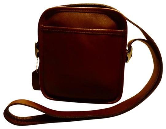 Preload https://item2.tradesy.com/images/coach-camera-zip-9817-brown-leather-cross-body-bag-23339731-0-1.jpg?width=440&height=440