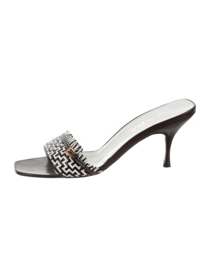 Preload https://item5.tradesy.com/images/prada-black-and-white-leather-buckle-sandals-size-eu-37-approx-us-7-regular-m-b-23339744-0-0.jpg?width=440&height=440