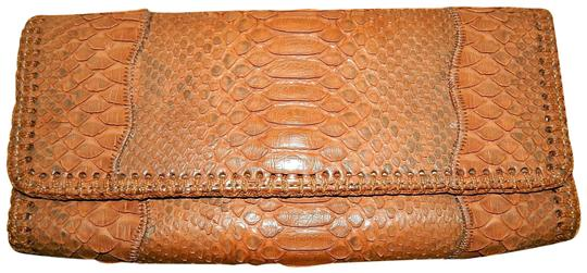 Preload https://item3.tradesy.com/images/carlos-falchi-fatto-o-mano-brown-python-skin-leather-clutch-23339772-0-1.jpg?width=440&height=440