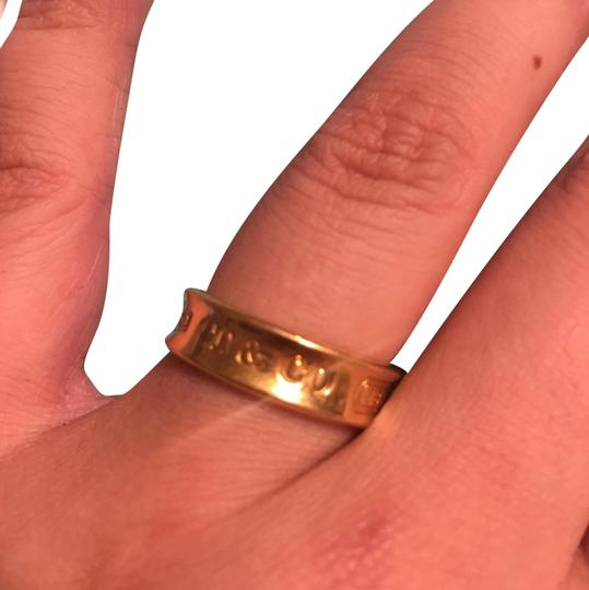 Preload https://item4.tradesy.com/images/tiffany-and-co-gold-18k-750-yellow-limited-edition-ring-23340008-0-1.jpg?width=440&height=440