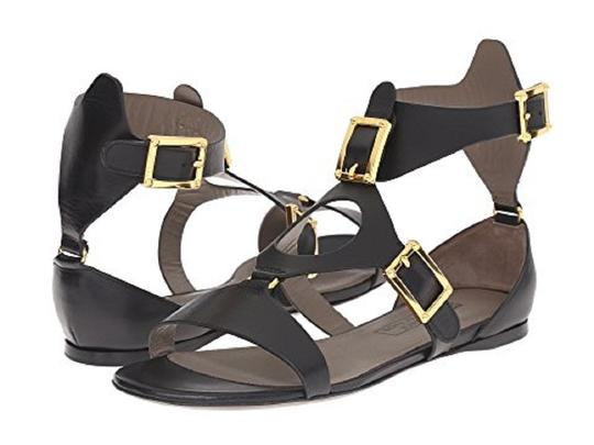Preload https://item1.tradesy.com/images/versace-collection-black-leather-gold-buckle-sandals-size-eu-38-approx-us-8-regular-m-b-23340010-0-0.jpg?width=440&height=440