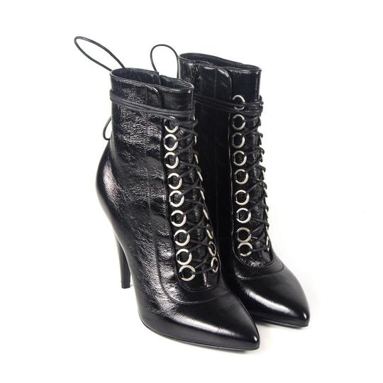 Preload https://item1.tradesy.com/images/saint-laurent-black-fetish-leather-lace-up-bootsbooties-size-eu-39-approx-us-9-regular-m-b-23340095-0-2.jpg?width=440&height=440