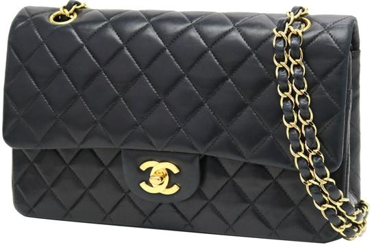 Preload https://item1.tradesy.com/images/chanel-quilted-medium-classic-double-flap-866782-black-leather-shoulder-bag-23340115-0-3.jpg?width=440&height=440