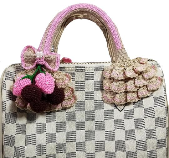 Preload https://item2.tradesy.com/images/beigepink-crochet-handle-covers-for-louis-vuitton-speedy-alma-23340136-0-1.jpg?width=440&height=440