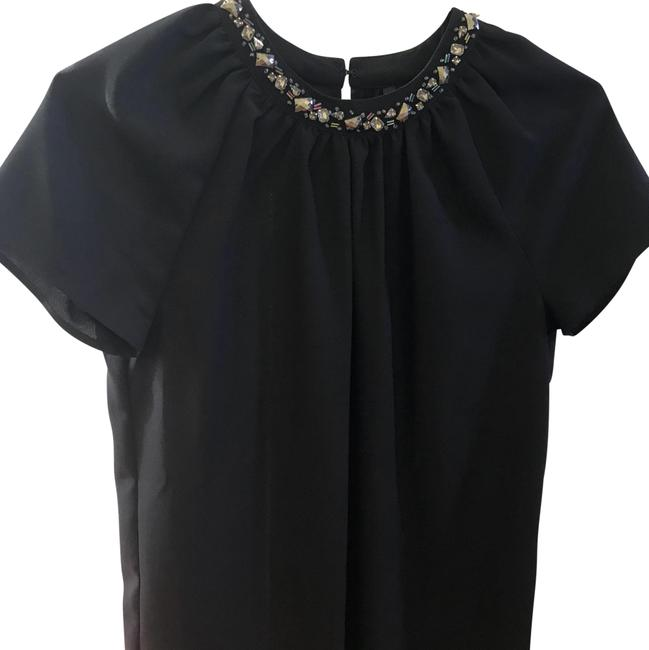 Preload https://item5.tradesy.com/images/mango-neverfull-blouse-size-4-s-23340214-0-1.jpg?width=400&height=650