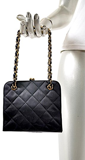 Preload https://img-static.tradesy.com/item/23340274/chanel-evening-quilted-handbag-w-laced-gold-chain-handles-black-satin-baguette-0-4-540-540.jpg