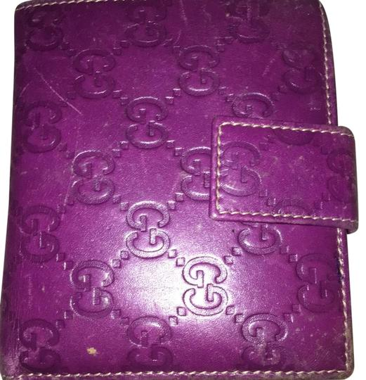 Preload https://item4.tradesy.com/images/gucci-purple-monogram-bifold-wallet-23340583-0-1.jpg?width=440&height=440