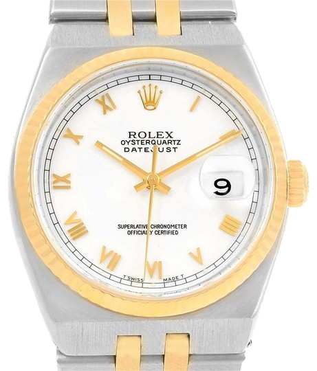 Preload https://item4.tradesy.com/images/rolex-white-oysterquartz-datejust-steel-yellow-dial-17013-watch-23340813-0-2.jpg?width=440&height=440