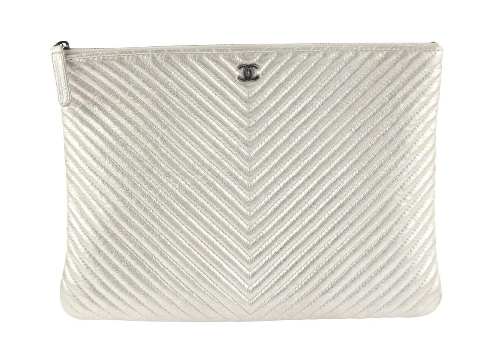 c334a841b09a Chanel Lambskin Leather Chevron O-case Silver Clutch Image 0 ...