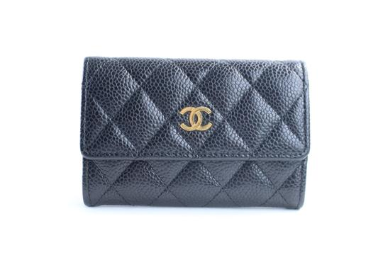 Preload https://item4.tradesy.com/images/chanel-quilted-caviar-flap-card-case-7cr0509-black-leather-clutch-23340923-0-0.jpg?width=440&height=440