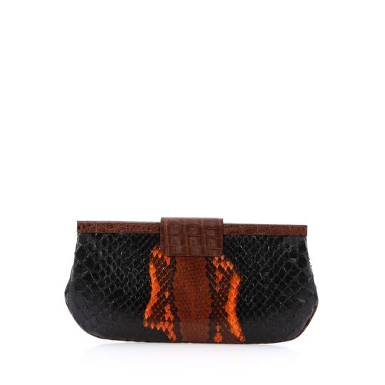 Preload https://img-static.tradesy.com/item/23341049/nancy-gonzalez-medium-black-and-orange-python-skin-leather-clutch-0-0-540-540.jpg