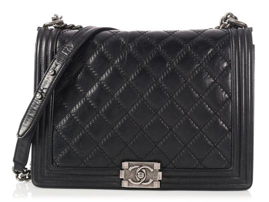 Preload https://item4.tradesy.com/images/chanel-boy-large-black-quilted-lambskin-leather-cross-body-bag-23341143-0-0.jpg?width=440&height=440