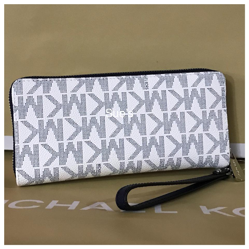 094e9e14bb95ce Michael Kors nwt mk jet set Travel Continental Wallet- navy/white Image 4.  12345