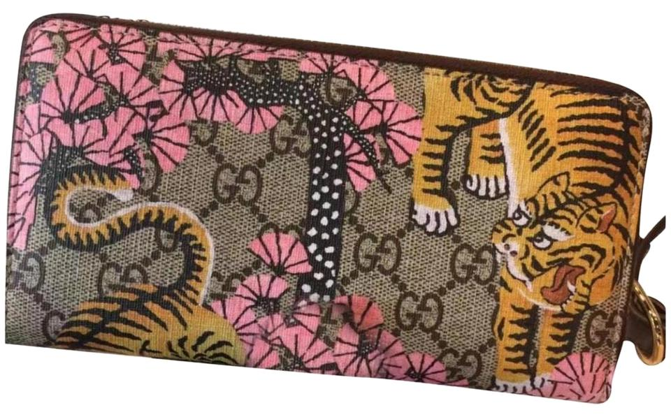 a29afcbed8ac Gucci GG Supreme tiger print leather wallet Image 0 ...