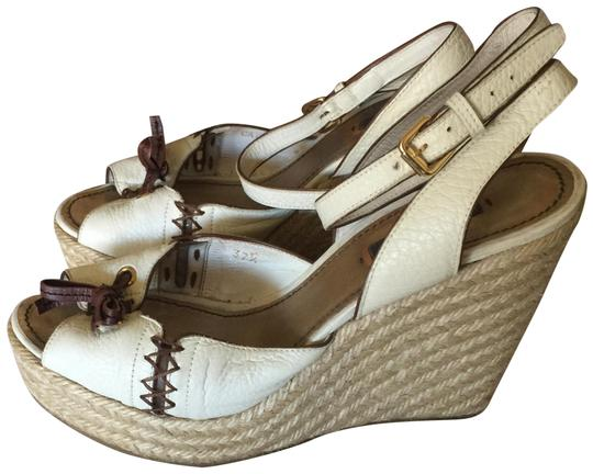 Preload https://img-static.tradesy.com/item/2334982/louis-vuitton-white-and-brown-wedges-size-eu-375-approx-us-75-regular-m-b-0-2-540-540.jpg