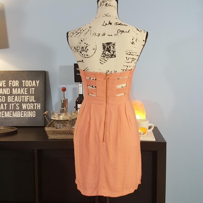 BCBGeneration short dress peach Viscose Cut Out Fully Lined on Tradesy