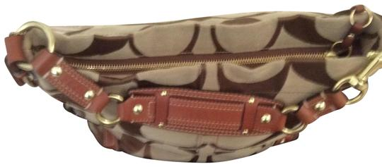Preload https://img-static.tradesy.com/item/23354678/coach-saddle-monogram-brown-khaki-fabric-exterior-with-leather-trimming-and-strap-hobo-bag-0-5-540-540.jpg