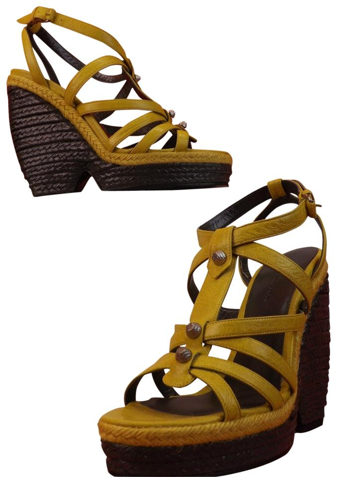 dee09e87bab Balenciaga Mustard Yellow Arena Leather Wedge Studded Sandals. Size  EU 39 ( Approx. US 9) ...