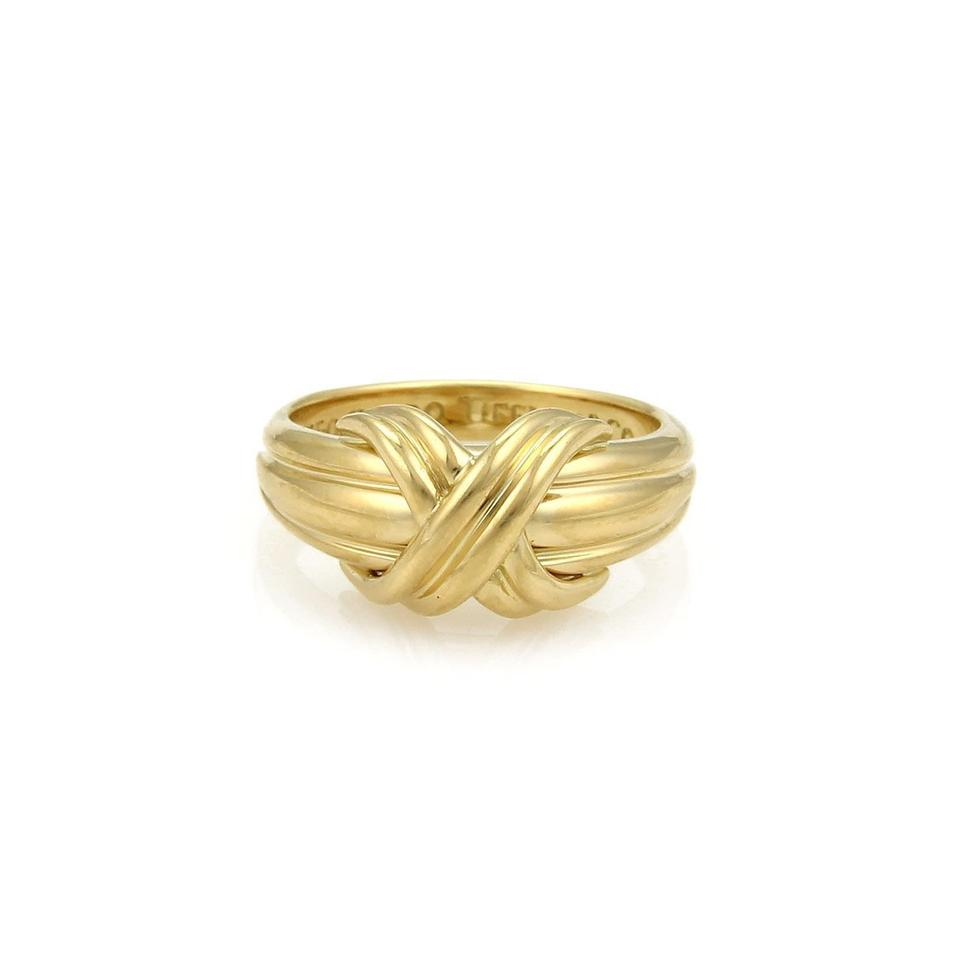 a64325e71 Tiffany & Co. 18k Yellow Gold X Crossover Grooved Ring Image 0 ...