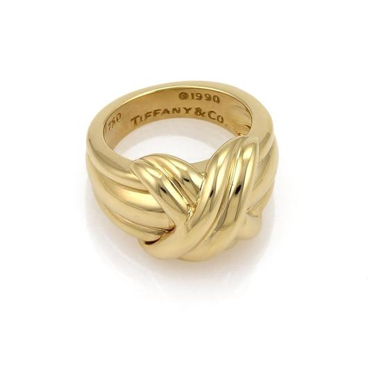 c1a2bf570 ... Tiffany & Co. 18k Yellow Gold X Crossover Grooved Ring Image 1