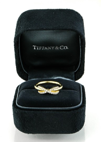 Preload https://img-static.tradesy.com/item/23357763/tiffany-and-co-18k-gold-infinity-with-diamonds-ring-0-0-540-540.jpg