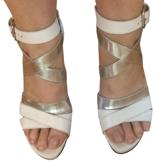 Preload https://item5.tradesy.com/images/stuart-weitzman-white-and-silver-strappy-leather-heels-platforms-size-us-75-regular-m-b-23366474-0-1.jpg?width=440&height=440