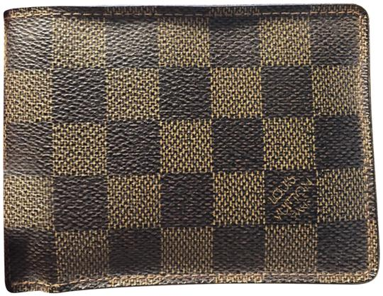 Preload https://item2.tradesy.com/images/louis-vuitton-damier-graphite-lv-multiple-wallet-23366476-0-1.jpg?width=440&height=440