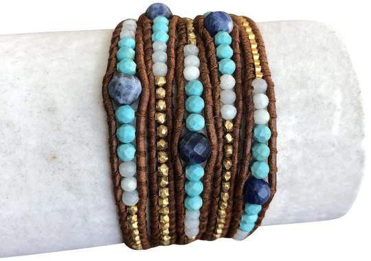 Preload https://img-static.tradesy.com/item/23366479/chan-luu-blue-new-graduated-sodalite-mix-five-wrap-brown-l-bracelet-0-1-540-540.jpg